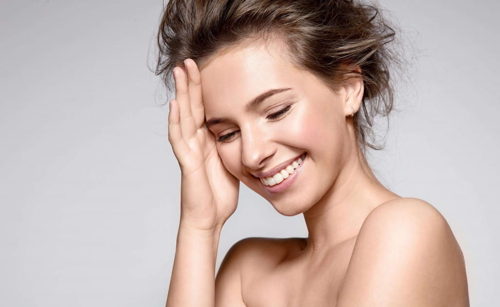 woman smiling after laser skin treatment